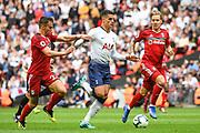 Tottenham Hotspur Midfielder Erik Lamela (11) assists Tottenham Hotspur Forward Harry Kane (10) in scoring a goal (3-1) during the Premier League match between Tottenham Hotspur and Fulham at Wembley Stadium, London, England on 18 August 2018.