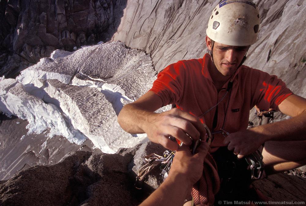 Dylan racks at the base of Mt. Slesse with the pocket glacier behind him.