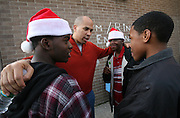 Cory Booker huddles with the boys he is mentoring as they to decide how to spend the afternoon.  Sean Bennett Laboo, LEFT,   DuWan Diggs  and Anthony Jackson, RIGHT, decide to go to the movies after attending a Toy giveaway at the JFK Recreation Center.