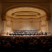 """March 6, 2012 - New York, NY : .Guest conductor Jon Oliver, standing in foreground, leads the Boston Symphony Orchestra featuring the Tanglewood Festival Chorus in Ludwig Van Beethoven's """"Missa solemnis in D Major, Op. 123 (1819-1823)' in Isaac Stern Auditorium at Carnegie Hall on Tuesday night..CREDIT : Karsten Mor"""