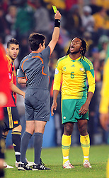Macbeth Sabaya get a yellow card  during the soccer match of the 2009 Confederations Cup between Spain and South Africa played at the Freestate Stadium,Bloemfontein,South Africa on 20 June 2009.  Photo: Gerhard Steenkamp/Superimage Media.