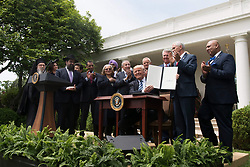 May 4, 2017 - Washington, DC, United States of America - U.S. President Donald Trump holds up the signed Executive Order Promoting Free Speech and Religious Liberty surrounded by members of different faiths during a signing ceremony in the Rose Garden of the White House May 4, 2017 in Washington, D.C. (Credit Image: © D. Myles Cullen/Planet Pix via ZUMA Wire)
