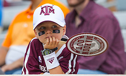 Texas A&M fan Caleb Walker watches warmups of an NCAA college football game between Texas A&M and UCLA on Saturday, Sept. 3, 2016, in College Station, Texas. (AP Photo/Sam Craft)