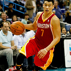 Jan 9, 2013; New Orleans, LA, USA; Houston Rockets point guard Jeremy Lin (7) drives with the ball against the New Orleans Hornets during the third quarter of a game at the New Orleans Arena. The Hornets defeated the Rockets 88-79. Mandatory Credit: Derick E. Hingle-USA TODAY Sports