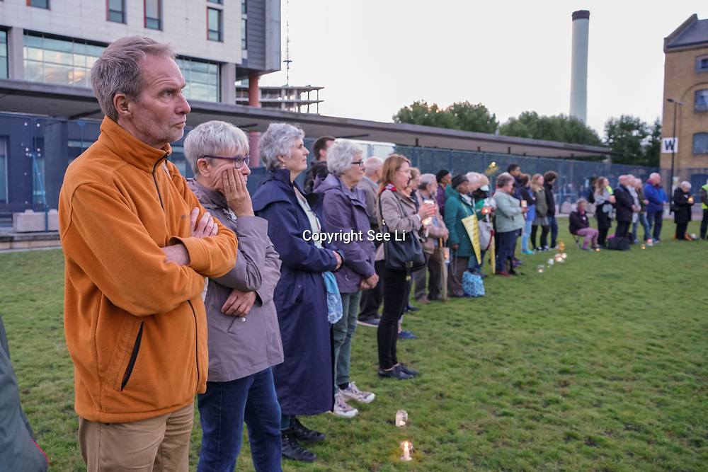 Excel London, London, UK, 11th September 2017. Pax Christi & Young Quakers hold a silent Candle-lit vigil to Stop the arms fair inside the compound of Excel London.