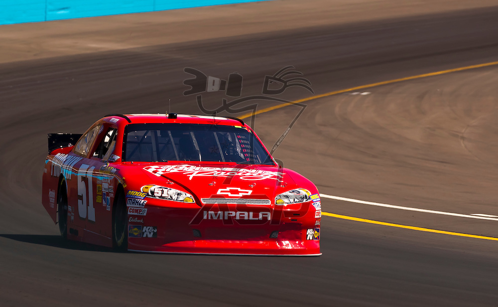 AVONDALE, AZ - MAR 03, 2012:  Kurt Busch (51) brings his NASCAR Sprint Cup car through turn 4 during qualifying for the Subway Fresh Fit 500 race at the Phoenix International Raceway in Avondale, AZ.
