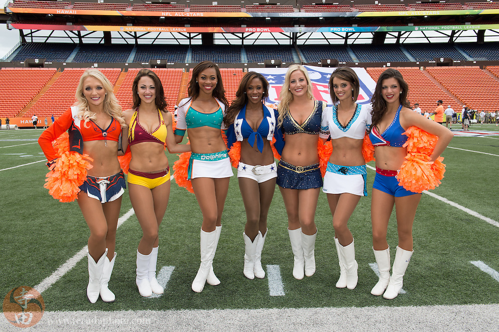 January 25, 2014; Honolulu, HI, USA; NFL Pro Bowl cheerleaders (L-R) Denver Broncos cheerleader Heather Hartman, Washington Redskins cheerleader Maigan, Miami Dolphins cheerleader Natalie, Dallas Cowboys cheerleader Jackie Bob, St. Louis Rams cheerleader Aimee Scheuneman, Carolina Panthers cheerleader Laura Bebo, and Buffalo Bills cheerleader Emily Wilhelm pose for a photo during the 2014 Pro Bowl Ohana Day at Aloha Stadium.