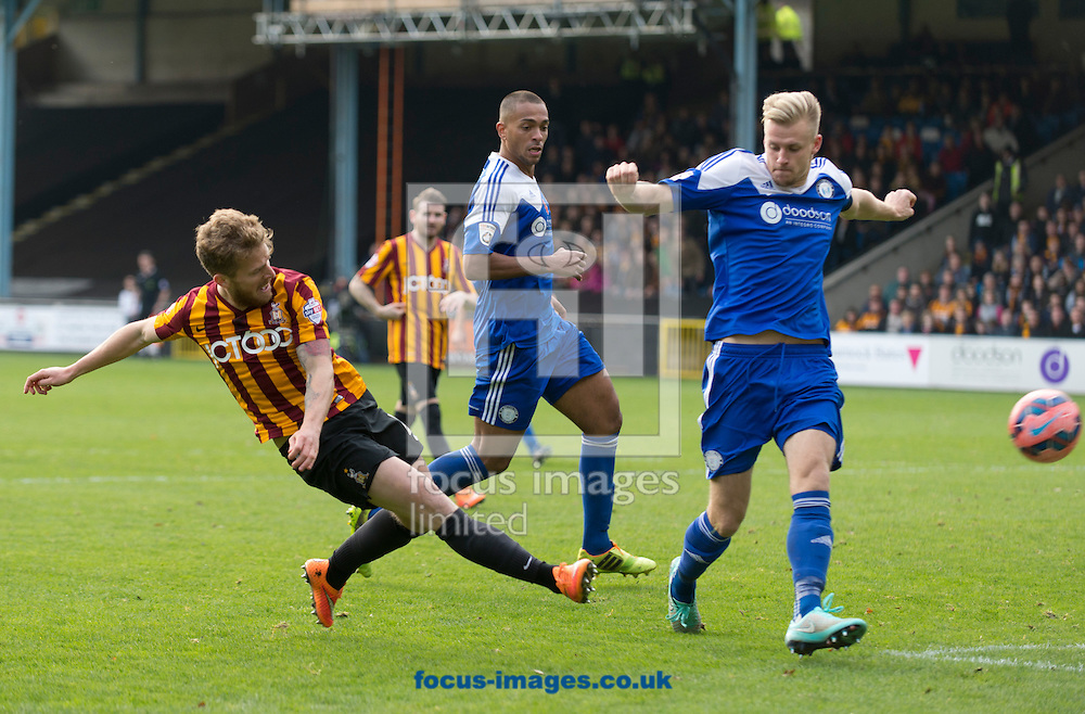 Billy Clarke of Bradford City shoots at goal as Marc Roberts of FC Halifax Town closes down during the The FA Cup match at Shay Stadium, Halifax<br /> Picture by Russell Hart/Focus Images Ltd 07791 688 420<br /> 09/11/2014