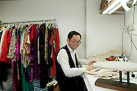 Mr Lau On Hing one of the last qipao maker photographed in his workshop, Lan Kwai Fong, Hong Kong.