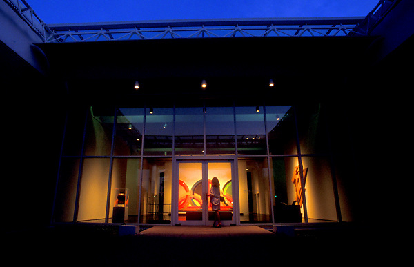 Stock photo of a woman at the entrance of the Menil Collection in Houston Texas