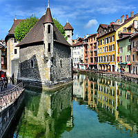 Palais de I&rsquo;Isle Reflecting in Thiou Canal in Annecy, France  <br />