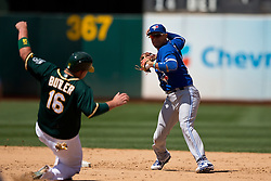 OAKLAND, CA - JULY 23:  Ryan Goins #17 of the Toronto Blue Jays completes a double play around Billy Butler #16 of the Oakland Athletics during the ninth inning at O.co Coliseum on July 23, 2015 in Oakland, California. The Toronto Blue Jays defeated the Oakland Athletics 5-2. (Photo by Jason O. Watson/Getty Images) *** Local Caption *** Ryan Goins; Billy Butler