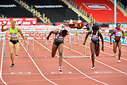 Danielle Williams (JAM) dips to win the women's 100m hurdles Final equalising the Meeting Record time of 12.46 ahead of Tobi Amusan (NGR) during the Birmingham Grand Prix, Sunday, Aug 18, 2019, in Birmingham, United Kingdom. (Steve Flynn/Image of Sport via AP)