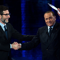 Milan, Italy -  24-05-2015: Former prime minister of Italy and President of Forza Italia, Silvio Berlusconi (R), waves at the audience during the show 'Che Tempo Che Fa, hosted by Fabio Fazio (L)