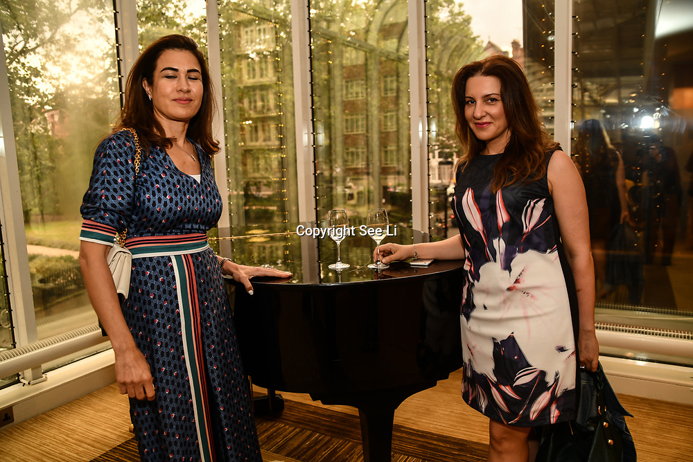 Attendees at the London Arabia Art & Fashion Week 2019 exhibition Arabs art and showcases fashion show at Jumeirah Carlton Tower, on 5 August 2019, London, UK.