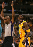 The Lakers' Kobe Bryant sticks his tongue out toward the crowd after scoring a three point basket against the New Orleans Hornets during the first half at Staples Center Wednesday April 19, 2006.