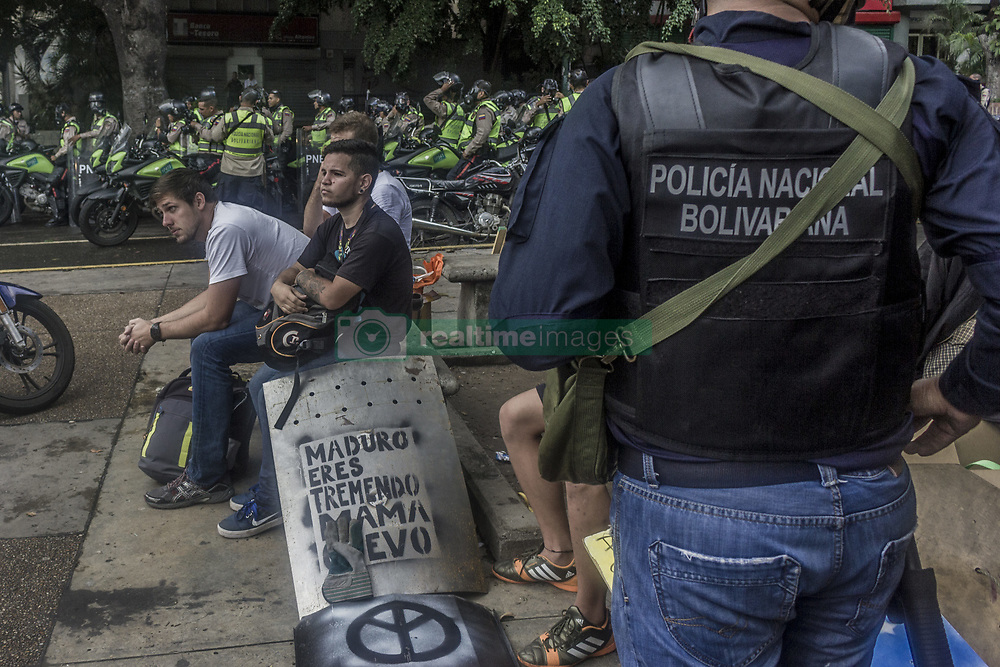 June 19, 2017 - Caracas, Distrito Capital, Venezuela - Police officers detain a youth during anti-government protests in Caracas, Venezuela, Monday, June 19, 2017. Nearly 70 people have died, hundreds more have been injured and thousands have been detained in months of almost daily protests demanding new elections as the nation battles triple-digit inflation, crippling food and medical shortages and rising crime. (Credit Image: © Marcos Canizares/VW Pics via ZUMA Wire)