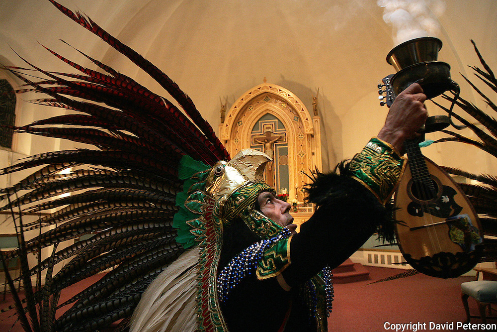 Manuel Cano, from Cd. Juarez Chih, Mexico, holds incense aloft before performing a traditional Aztec dance along with others from his town at the Visitation Church in Des Moines, Iowa.   It was the first dance of the evening during the feast of Our Lady Guadalupe celebration.