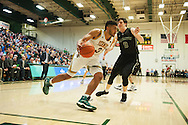 Vermont's Anthony Lamb (3) drives to the hoop past Dartmouth's Will Emery (0) during the men's basketball game between the Dartmouth Big Green and the Vermont Catamounts at Patrick Gym on Wednesday December 7, 2016 in Burlington (BRIAN JENKINS/for the FREE PRESS)