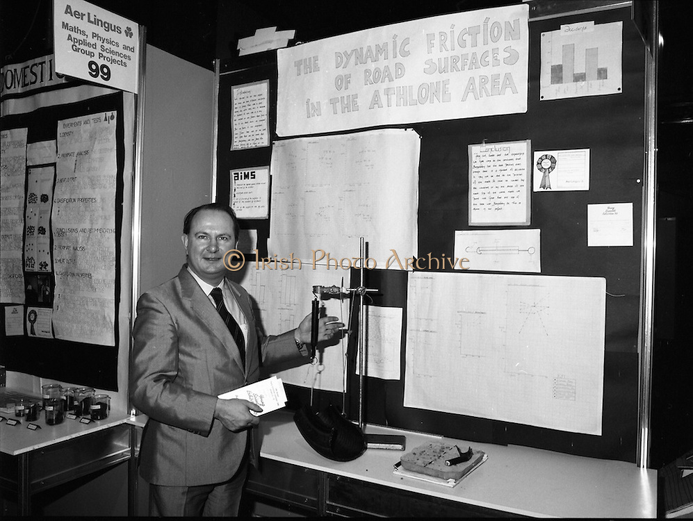 08/01/1988.01/08/1988.8th January 1988 .The Aer Lingus Young Scientist of the Year Award at the RDS, Dublin..Picture shows Con Power, Director of Economic Policy Confederation of Irish Industry looking at the project 'Study of Road Surfaces in Athlone' entered by Naomi Magliocco and Paula Starken from Our Lady's Bower School, Athlone, Co. Westmeath, one of the entries which won a prize sponsored by the CII.