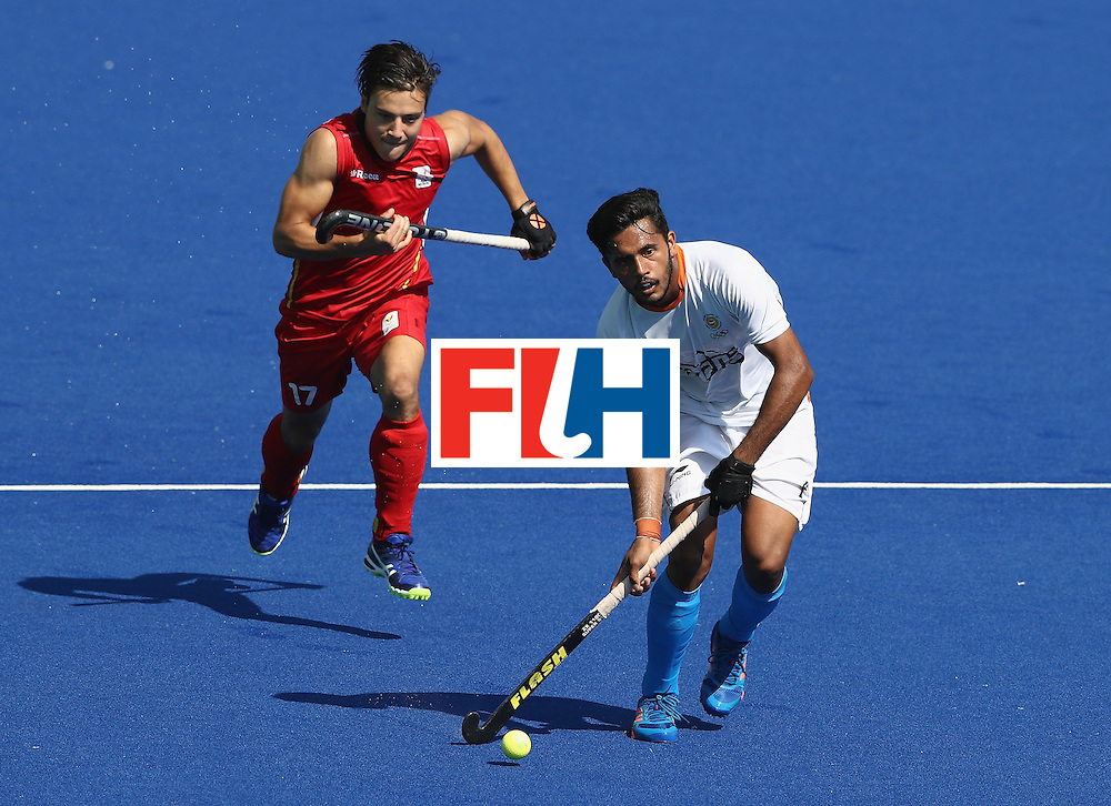 RIO DE JANEIRO, BRAZIL - AUGUST 14:  Hamanpreet Singh of India plays the ball as Thomas Briels attempts to challenge during the Men's hockey quarter final match between Belgium and India on Day 9 of the Rio 2016 Olympic Games at the Olympic Hockey Centre on August 14, 2016 in Rio de Janeiro, Brazil.  (Photo by David Rogers/Getty Images)