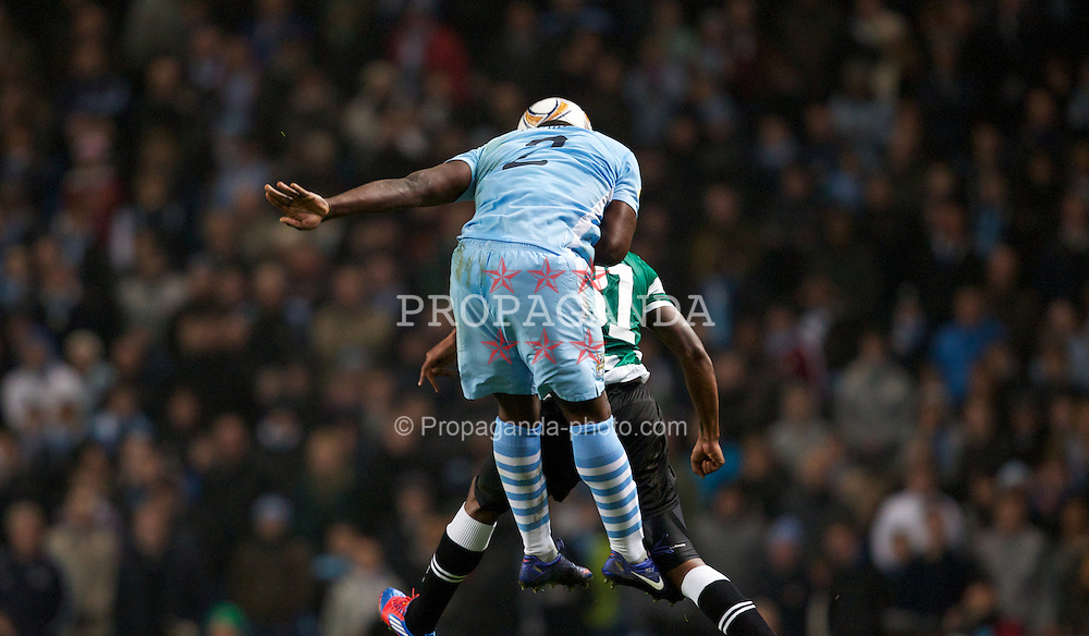 MANCHESTER, ENGLAND - Thursday, March 15, 2012: Manchester City's Micah Richards in action against Sporting Clube de Portugal's Renato Neto during the UEFA Europa League Round of 16 2nd Leg match at City of Manchester Stadium. (Pic by Vegard Grott/Propaganda)