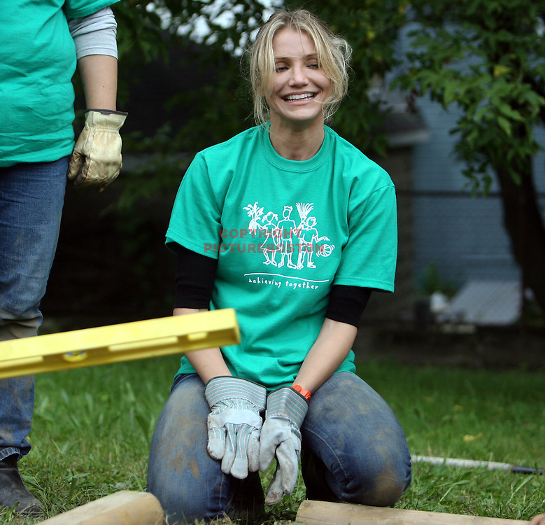 (09/11/09-Boston,MA) Cameron Diaz helps erect a wooden fence on the nation's first National Day of Service and Remembrance. Diaz, along with members of the Celtics, City Year and Harvard Pilgrim Health volunteered at the Young Achievers Pilot School in Mattapan. Staff Photo by Mark Garfinkel  .