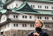 """Chris  """"Sora"""" O'Neil performs a trick with his sword in the grounds of Nagoya Castle, Aichi Prefecture Japan on Feb. 23, 2017. O'Neil is one of the eight ninja corps who roam the avenues of the castle and Nagoya Airport, jumping from behind trees and bushes to surprise visitors. ROB GILHOOLY PHOTO"""