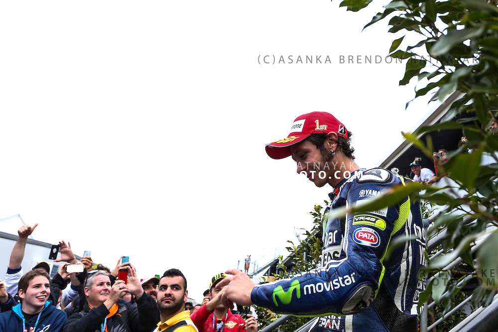 Valentino Rossi riding for Movistar Yamaha MotoGP walks down after the podium celebration to a crowd of fans after winning in his 250th moto gp race during the 2014 MotoGP of Australia at Phillip Island Grand Prix Circuit in Phillip Island, Australia. Photo Asanka Brendon Ratnayake
