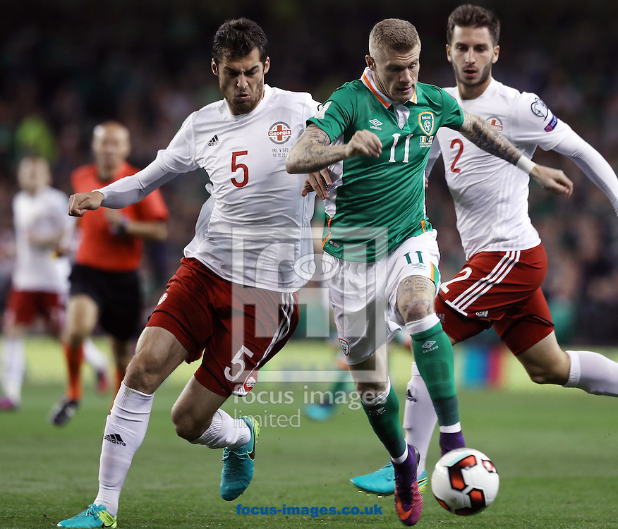 James McClean of Republic of Ireland and Solomon Kverkvelia of Georgia during the 2018 FIFA World Cup Qualifying match at the Aviva Stadium, Dublin<br /> Picture by Lorraine O'Sullivan/Focus Images Ltd +353 872341584<br /> 06/10/2016