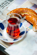 Turkish breakfast snack including simit, Turkish tea, rock samphire and curd cheese, Istanbul, Turkey, 2015–11-14.