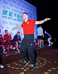 NANNING, CHINA - Saturday, March 24, 2018: Wales' Sam Vokes plays Chinese whispers charades and describes a mascot during a meet & greet event at the Nanning Wanda Mall during the 2018 Gree China Cup International Football Championship. (Pic by David Rawcliffe/Propaganda)