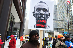 "A protester carries a sign reading, ""Save Owens."" Jesse Owens, named after the late US Olympian Jesse Owens, is one of 54 schools slated for closure."