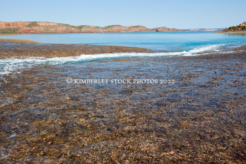 Water cascades off Turtle Reef in Talbot Bay as the tide falls.  Turtle Reef is a massive fringing reef complex  linking islands with the mainland.