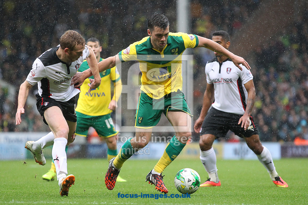 Jonny Howson of Norwich and Paul Green of Rotherham United in action during the Sky Bet Championship match at Carrow Road, Norwich<br /> Picture by Paul Chesterton/Focus Images Ltd +44 7904 640267<br /> 04/10/2014
