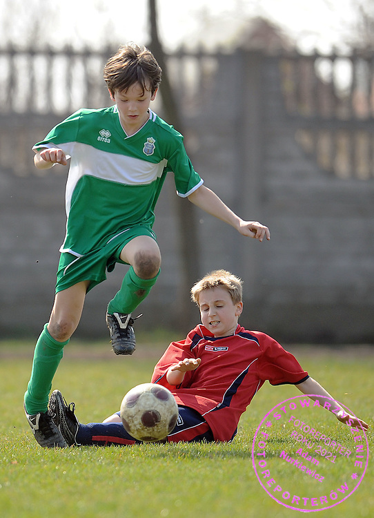 (L) MATEUSZ GUZKOWSKI (UKS LADY) DURING SOCCER MATCH BETWEEN UKS LADY AND SEMP WARSAW AT CHILDREN'S LEAGUE (FOR BOYS BORN AT 1998 OR LATER) SEASON 2008/2009...LADY VILLAGE NEAR WARSAW , POLAND , APRIL 5, 2009..( PHOTO BY ADAM NURKIEWICZ / MEDIASPORT )..PICTURE ALSO AVAIBLE IN RAW OR TIFF FORMAT ON SPECIAL REQUEST.