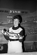 03-04/03/1964<br /> 03/03-04/1964<br /> 03-04 March 1964<br /> B.I.M. Fish Cookery Competition, Munster final, winners at the Metropole Hotel, Cork. The competition was held at the School of Commerce Cork. Photo Shows: Munster finalist Miss Phyllis Cliffe, Vocational School, Dungarvan (Knockkaun, Ballinamult) showing her prizewinning dish.