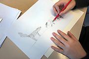 Saint-Cergue, décembre 2017. reportage dans une école spécialisée à St-Cergue, dans laquelle un chien scolaire est utilisé depuis le début de l'année pour venir en aide et calmer les élèves. C'est le premier chien à être utilisé de la sorte en Suisse romande. Dessins inspirés par la présence de la chienne en classe. © Olivier Vogelsang