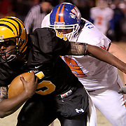 James Kenan's Dominique Barnes rushes against Whiteville's Spencer Campbell. (Jason A. Frizzele)