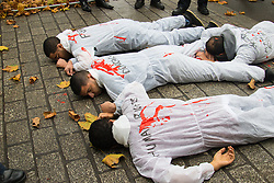 """Downing Street, London, November 5th 2015. British Prime Minister David Cameron welcomes Egyptian President Abdel Fatah al-Sisi to 10 Downing Street as demonstrations in support and counter-protests against his visit to the UK by a coalition of human rights groups take place in Whitehall. PICTURED: """"Dead"""" human rights protester block the entrance to Downing Street. // Licencing Contact: paul@pauldaveycreative.co.uk Mobile 07966 016 296"""