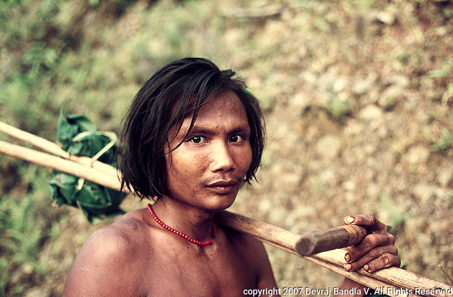 A man of the very primitive  'Shompen' tribe living in the remote interior Evergreen tropical rain forests of the Great Nicobar island,close to Sumatra in Indonesia.This tribe may become extinct if no proper conservation measures are implemented immediately.The survival of this tribe is very important to Anthropology.This portrait is probably one of the few professional images of the tribe available.