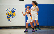 Milton's Megan Reilly (2) greets Madison Chalmers (52) on the court for player introductions during the girls basketball game between Lamoille and Milton at Milton High School on Friday night December 18, 2015 in Milton, (BRIAN JENKINS/for the FREE PRESS)