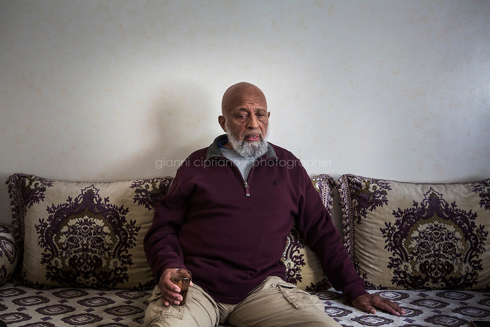 CASABLANCA, MOROCCO - 14 MAY 2016: Luqman Abdul-Hakeem (82), a close follower of Malcolm X that chauffeured the African American activist around and introduced him to Cuban leader  Fidel Castro in September 1960, is here during an interview in his home in Sidi Maarouf, a district of Casablanca, Morocco, on May 14th 2016.<br /> <br /> Born in Cleveland, OH, in 1934, Luqman Abdul-Hakeem was raised in Flushing, Queens, and then moved to Bayside, where he graduated in 1952. He attended the New York Technical University for a few months before enrolling in the Navy, where he stayed for two years. Though he had asked for ship duty, he ended up in Springfield, Mass., and Glennclose, Ill. He moved to Brooklyn when his hitch was done and by 1966 was studying jujitsu and aikido. He met Malcolm X during one of his sermons on 116th street in Harlem, New York, in the late 50&rsquo;s. In 1985, Mr. Hakeem decided to move to Marocco because America wasn't a country where he wanted to raise hois children. He has been teaching aikido in the two dojos he owns in Casablanca until 2014, when he underwent a surgery.