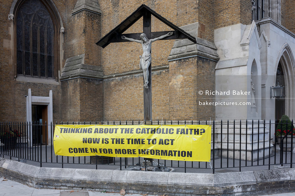 A banner advertising for new followers for the Catholic church, on 21st September 2016, in Waterloo, SE1, south London borough of Southwark, England UK
