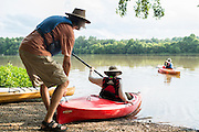 Lawrence Peterson, owner of Haw River Kayak and CAnoe, launches paddlers into the lake above the dam on the Haw River in Saxapahaw.