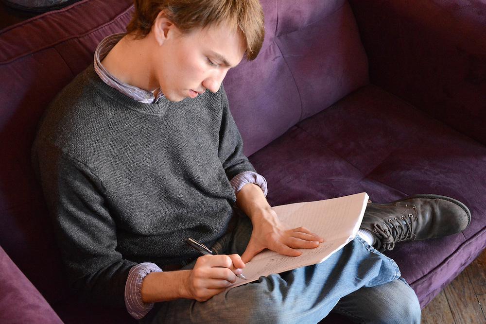 Ohio University senior HTC English major James Chrisman edits a journal at Donkey Coffee in Athens, Oh.