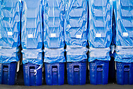 Stacks of blue recycling bins stand ready for distribution to the town of Bend, Oregon.