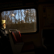A commuter rests on train from Washington DC to Fairfax, VA.