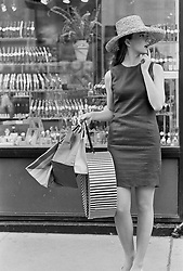 Young woman with shopping bags in New York