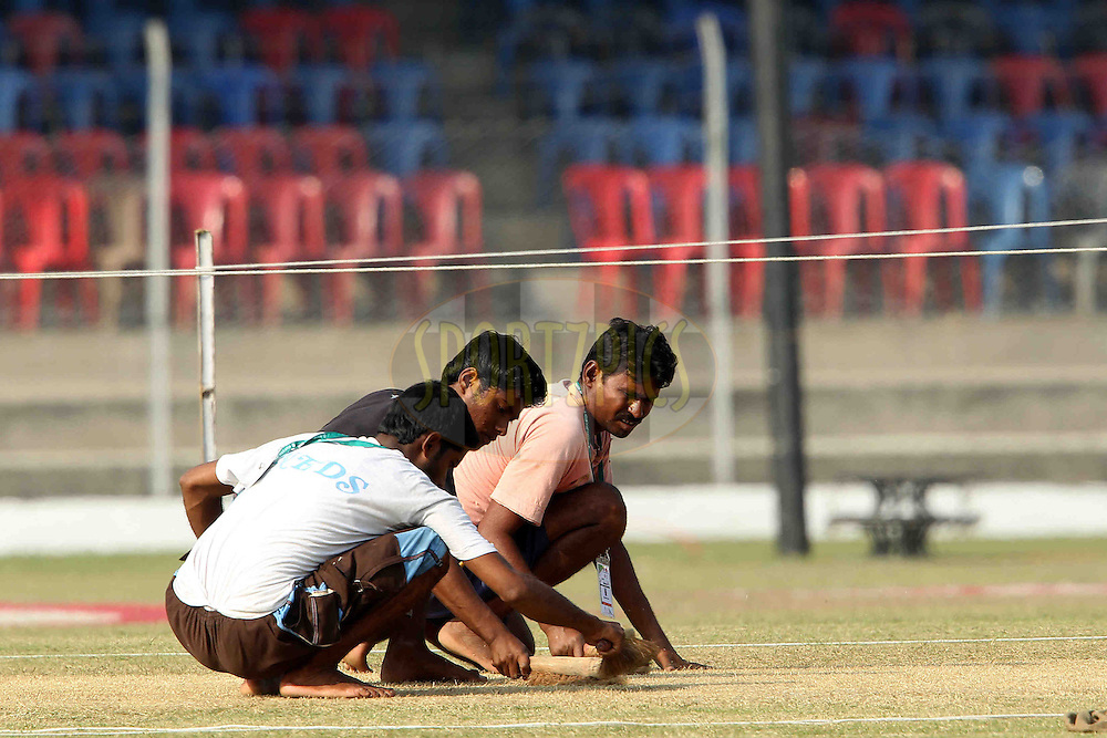 Cleaning the wicket during the Indian team training session held at the Nehru Cricket Stadium in uwahati, Assam, India on the 27th  November 2010..Photo by Ron Gaunt/BCCI/SPORTZPICS
